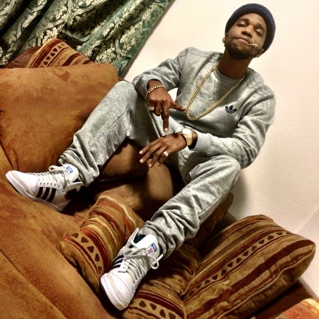 Currensy wearing adidas Originals Top Ten