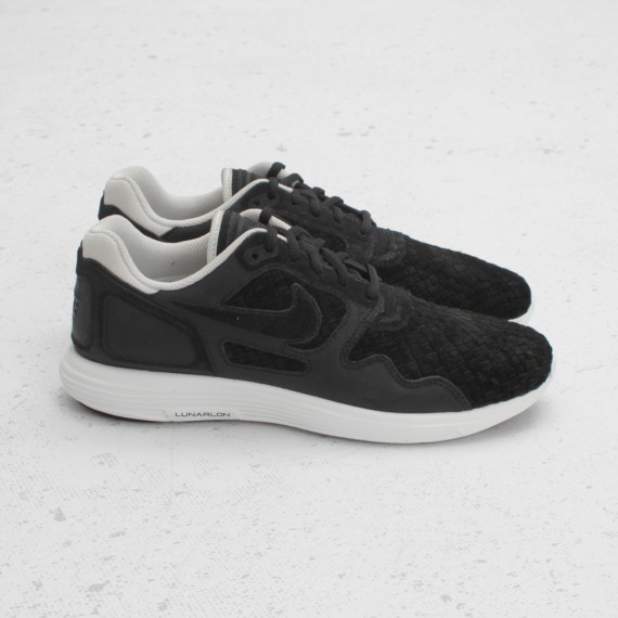 premium selection 61309 d1e97 After seeing two impressive colorways release just last month, Nike  Sportswear is continuing to show the Lunar Flow Woven love with this all  new black-based ...