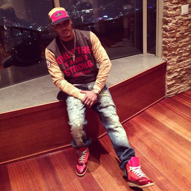 T.I. wearing Maison Martin Margiela High-Top Sneakers