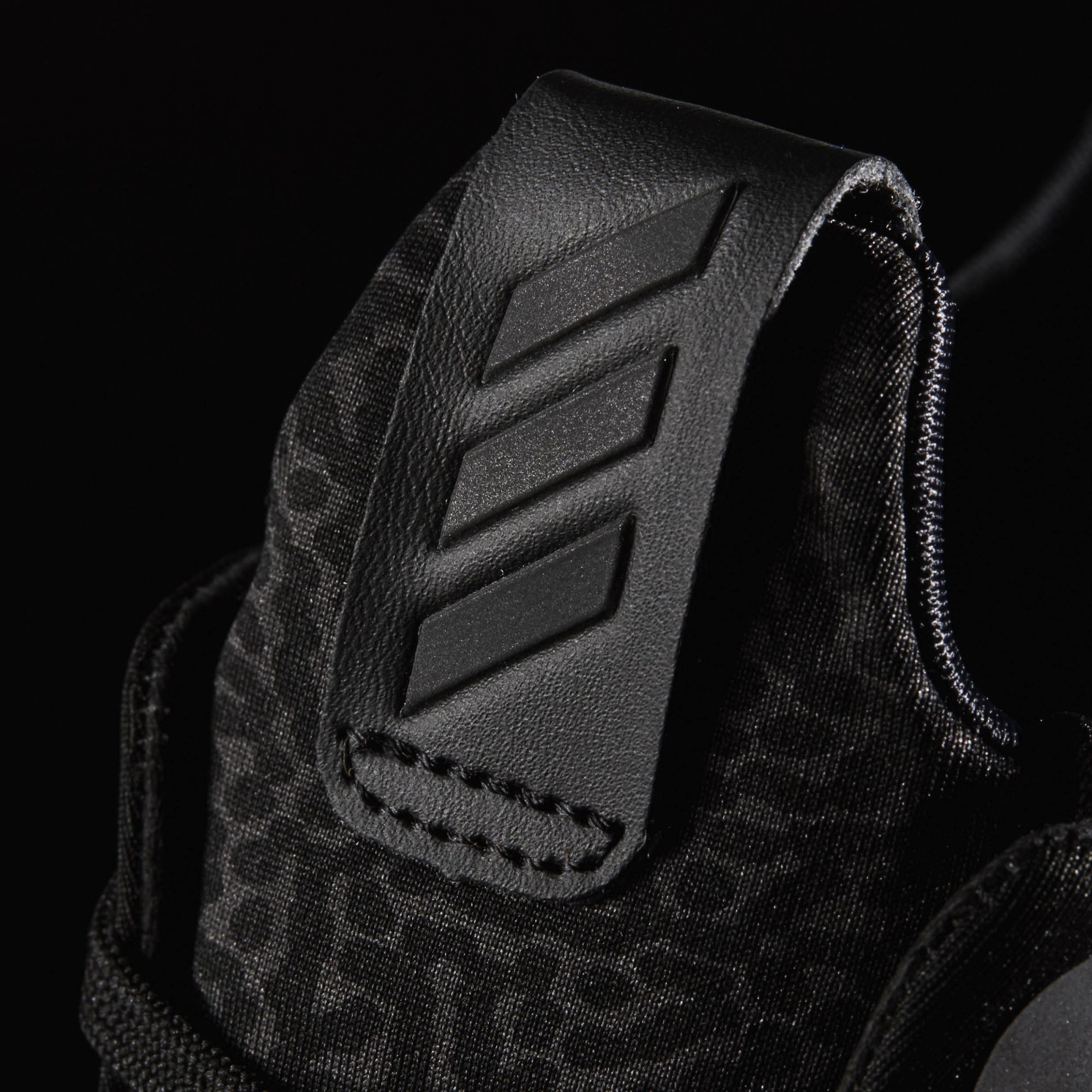 best sneakers a2815 4413a Image via Adidas Triple Black Adidas Alpha Bounce Xeno Heel Detail