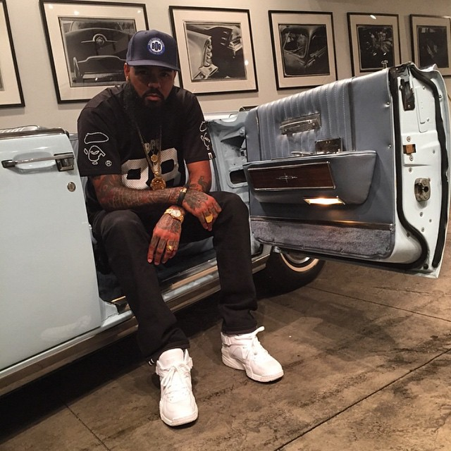 Stalley wearing Pigalle x Nike Air Raid White