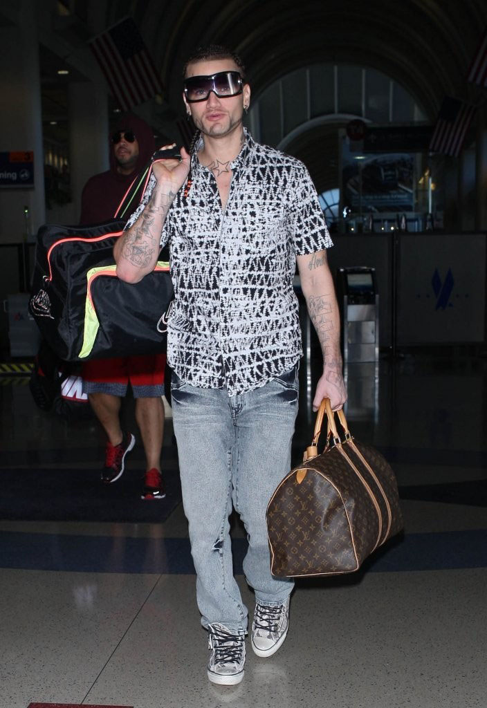 Riff Raff wearing Converse by John Varvatos Chuck Taylor All Star Snake