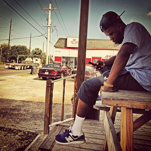 Curren$y wearing New Balance 574