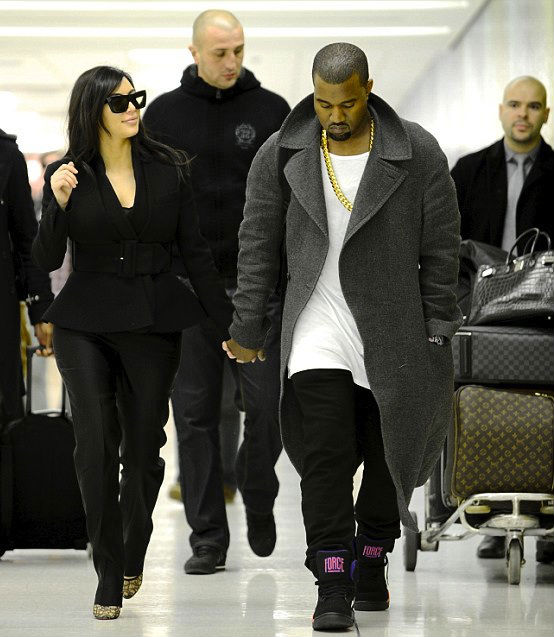 Kanye West wearing Nike Air Force 180 Mid Suns (1)