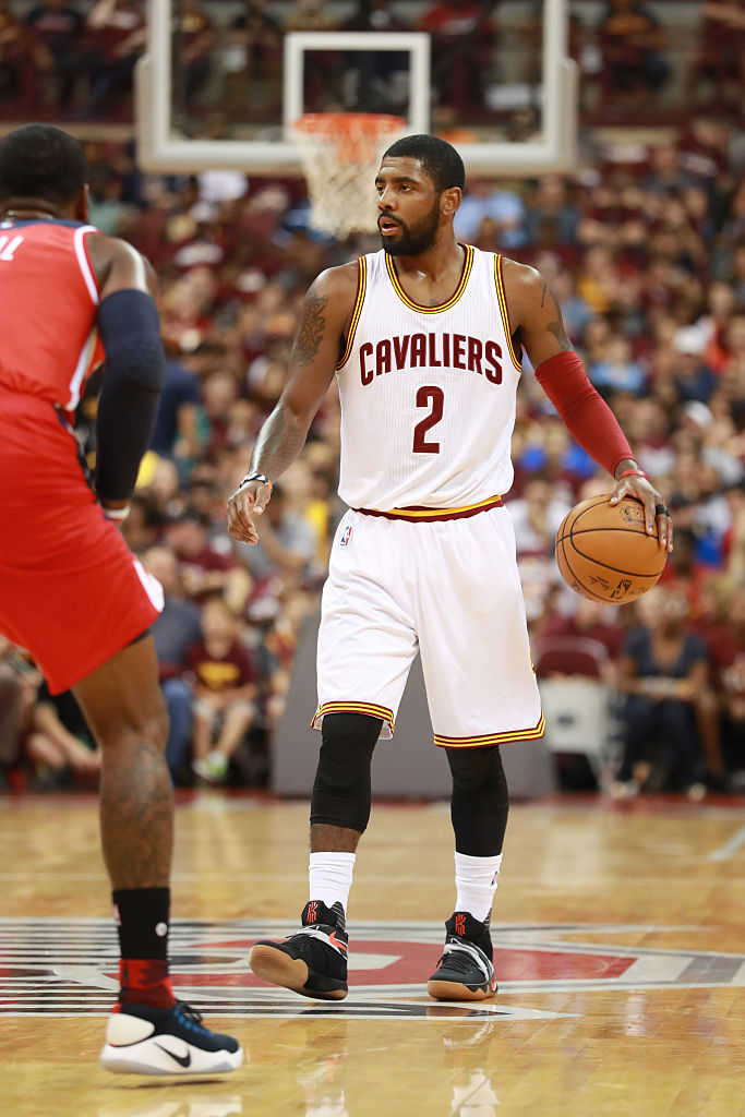 newest 6b6e7 97bd9 Kyrie Irving Wearing a Black/White-Orange-Gum Nike Kyrie 2 ...
