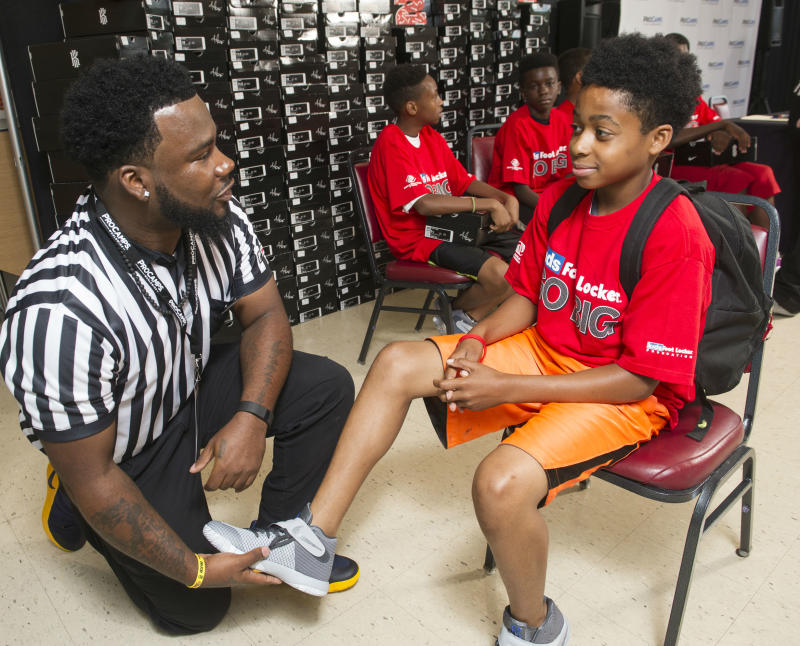 Foot Locker & Kyrie Irving Donate 190 Pairs of Sneakers to Kids (3)