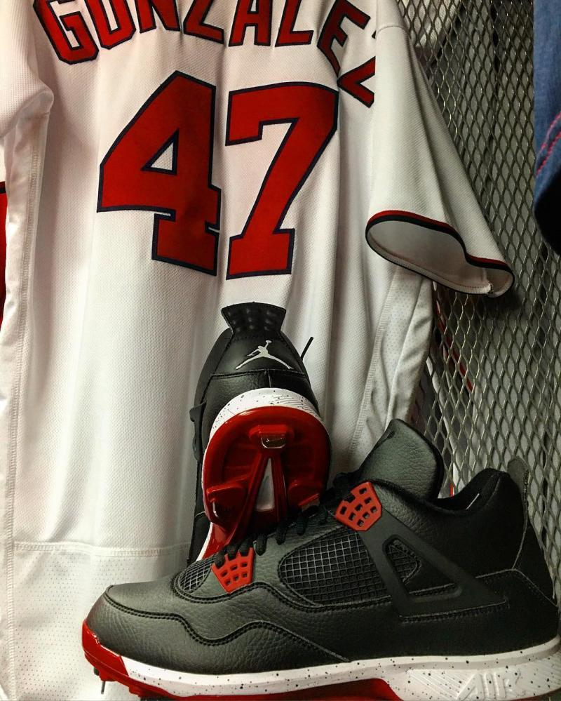Gio Gonzalez Wearing Black/White-Red Air Jordan 4 Cleats (3)