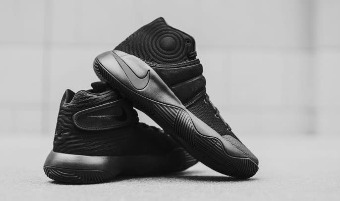 """1564f0542786 ... Kyrie Irvings """"Triple Black"""" Nike Kyrie 2 Sneakers Release This Weekend This  Nike Kyrie 2 is essentially draped in the stealthy hue across its Hyperfuse  ..."""