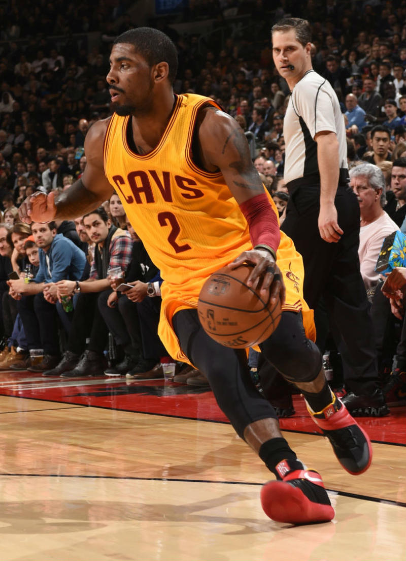 dba3712394e ... switzerland kyrie irving wearing a black red yellow nike kyrie 2 pe 2  1e2c8 4200c