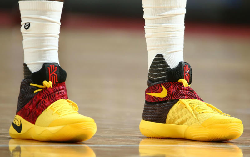 kyrie irving wearing a nike kyrie 2 blackyellowred pe