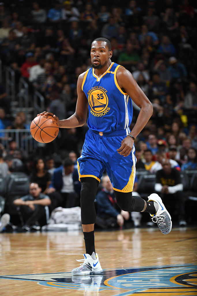 64af1016eb5 Image via Andrew D. Bernstein for Getty Images · Kevin Durant Wearing the Nike  KD 9 Warriors Multicolor Game