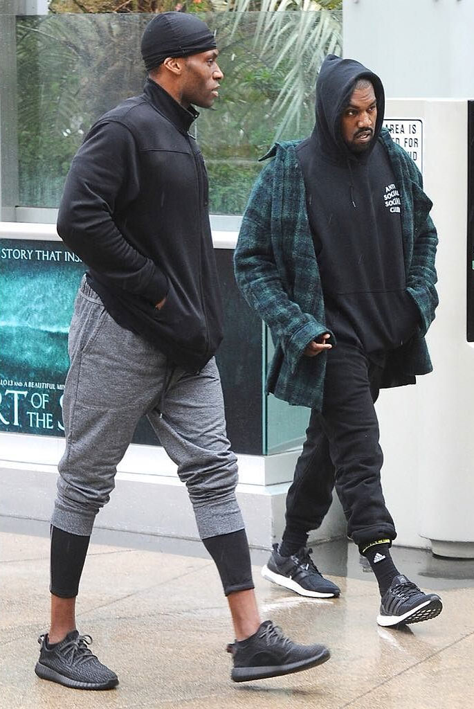 Kanye West wearing the Black adidas Ultra Boost