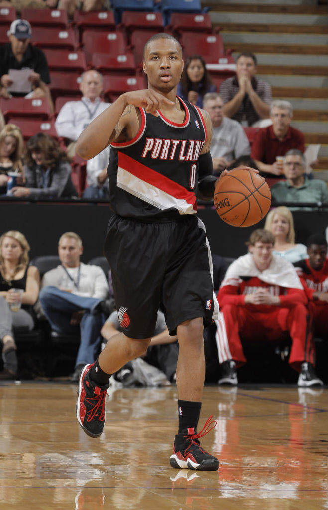 Damian Lillard wearing adidas Top Ten 2000 Black Red White