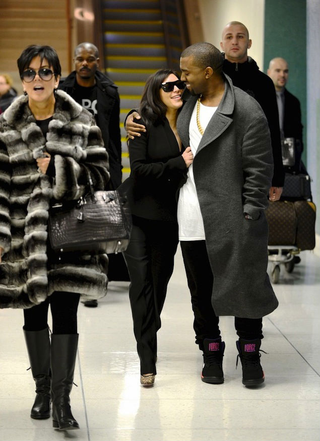 Kanye West wearing Nike Air Force 180 Mid Suns (3)