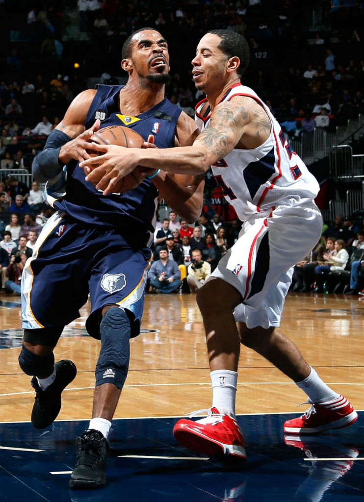 Mike Conley wearing adidas Rose 3 Blackout; Devin Harris wearing adidas Crazy Shadow