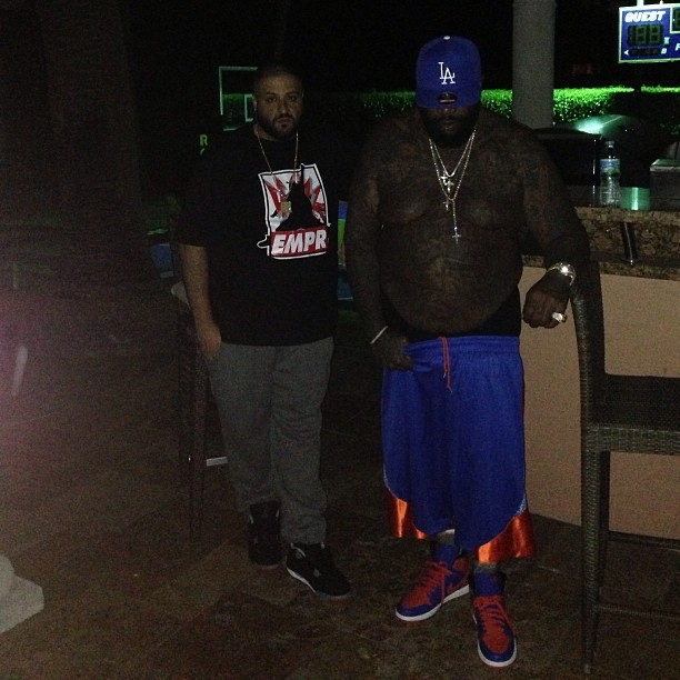 Rick Ross wearing Air Jordan I 1 Knicks; DJ Khaled wearing Air Jordan IV 4 Bred