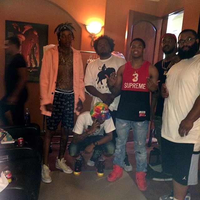 Mack Wilds wearing Nike Air Yeezy II 2 Red October; Wiz Khalifa wearing Converse Chuck Taylor All Star