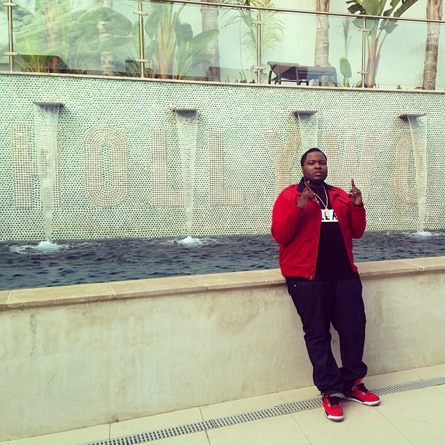 Sean Kingston wearing Air Jordan 4 Toro