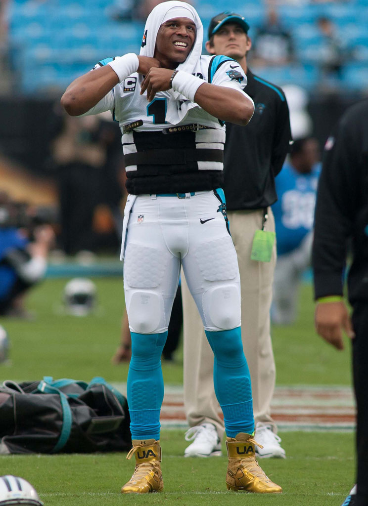 Cam Newton wearing Gold Under Armour Cleats (1)
