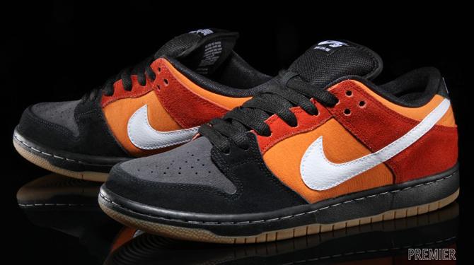 A Poor Man's 'Raygun' Nike SB Dunk Low. A familiar black and orange setup.