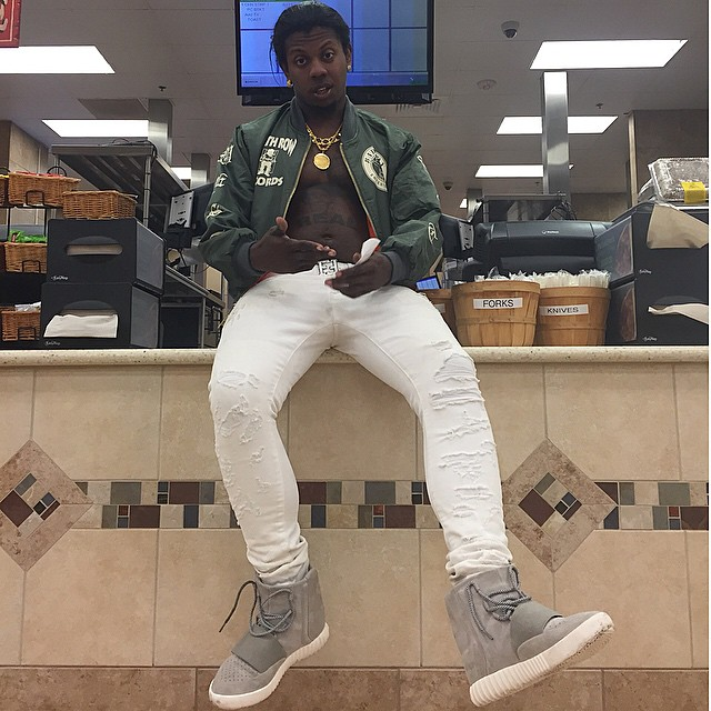Trinidad James wearing adidas Yeezy 750 Boost