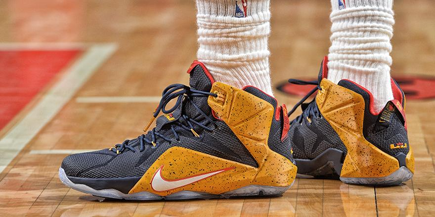 LeBron James wearing a Navy/Yellow-Red Nike LeBron XII 12 PE