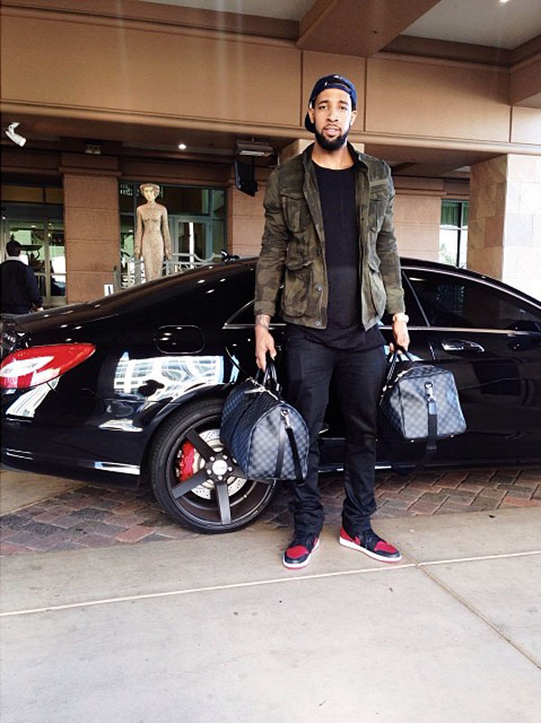 Derrick Williams wearing Air Jordan 1 Black/Red