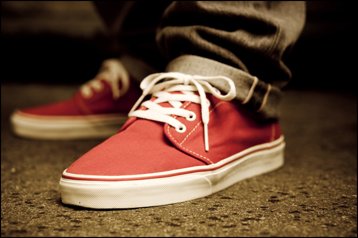 all red chukka low vans with red
