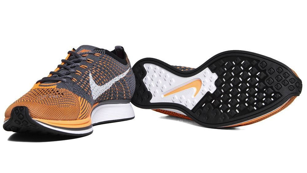f776aaf6a2f10 The Nike Flyknit Racer in Total Orange   White   Dark Grey is available now  at select retailers