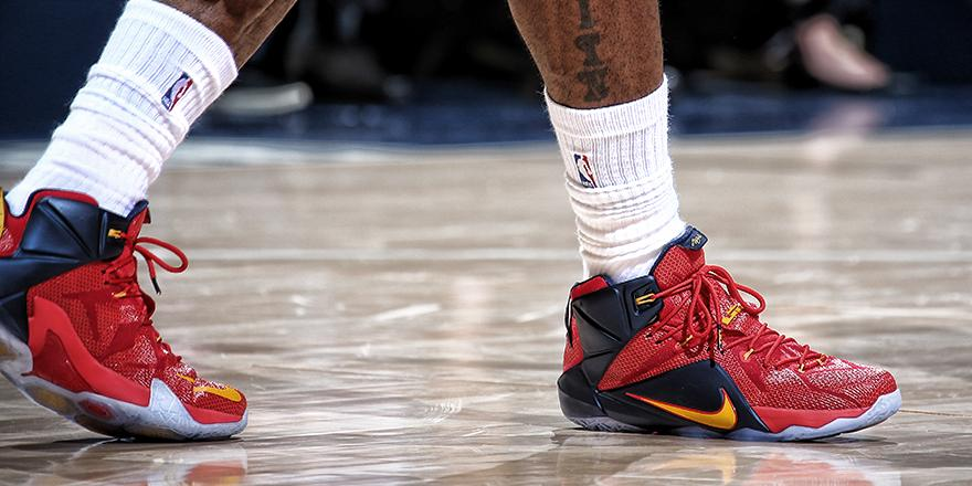 LeBron James wearing a Red/Navy-Yellow Nike LeBron XII 12 PE