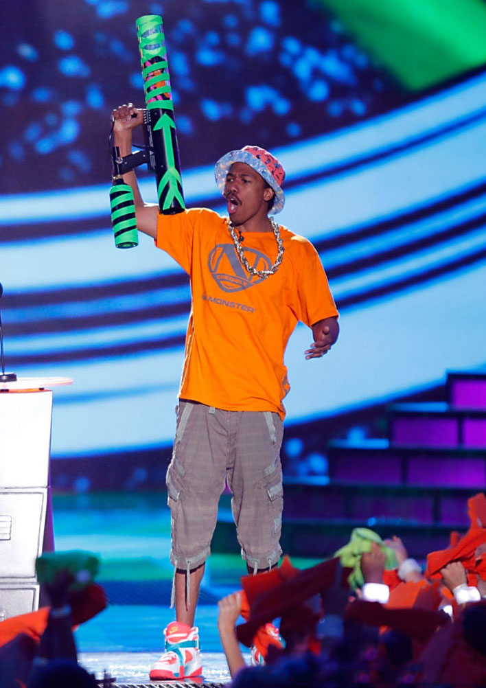 Nick Cannon wearing Nike Air Raid Atomic Mango