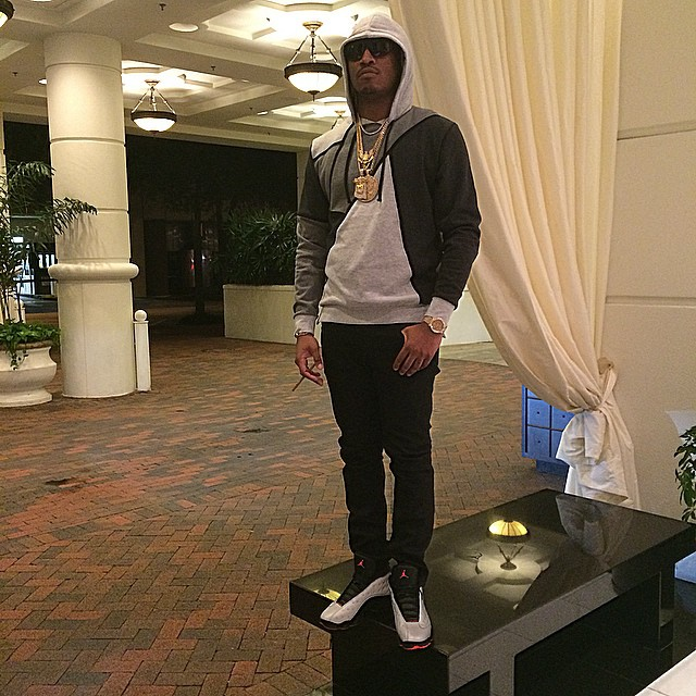 Future wearing Air Jordan XIII 13 Reflective Silver