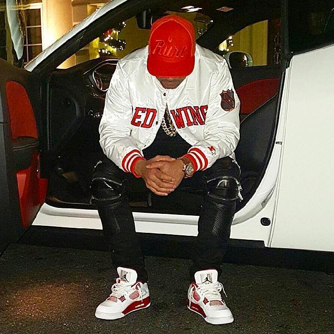 DJ Envy wearing the  Alternate  89  Air Jordan 4 b0b1f81808