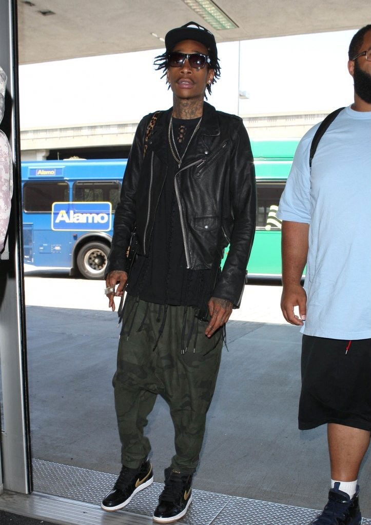 Wiz Khalifa wearing Air Jordan Retro I 1 Black Gold (3)