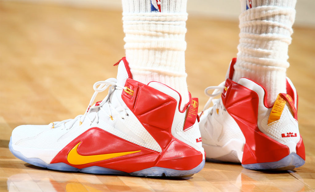 LeBron James wearing a White/Red-Yellow Nike LeBron 12 PE (1)