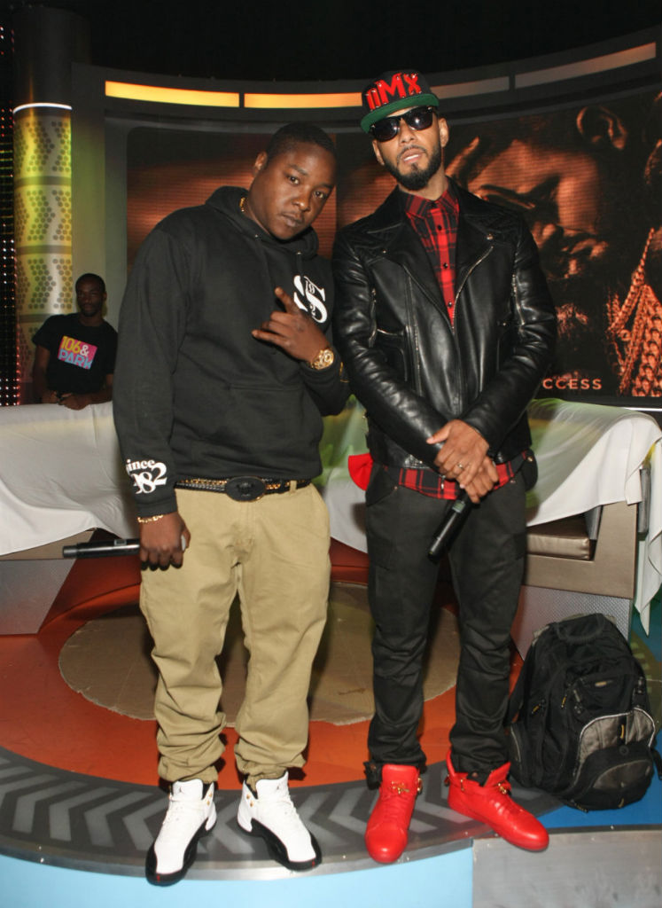 Jadakiss wearing Air Jordan 12 XII Retro Taxi;