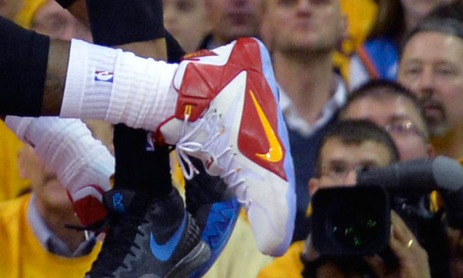 LeBron James wearing Nike LeBron XII 12 White/Red-Yellow PE on January 25, 2015
