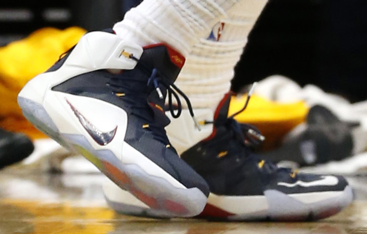 35910f72a15dd ... closeout lebron james wearing nike lebron 12 navy white red yellow pe 2  7303d 48baa