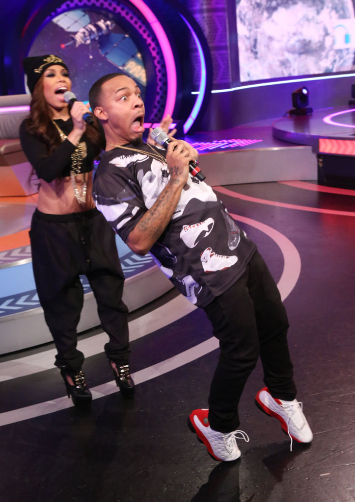Bow Wow wearing Air Jordan 13 White/Red