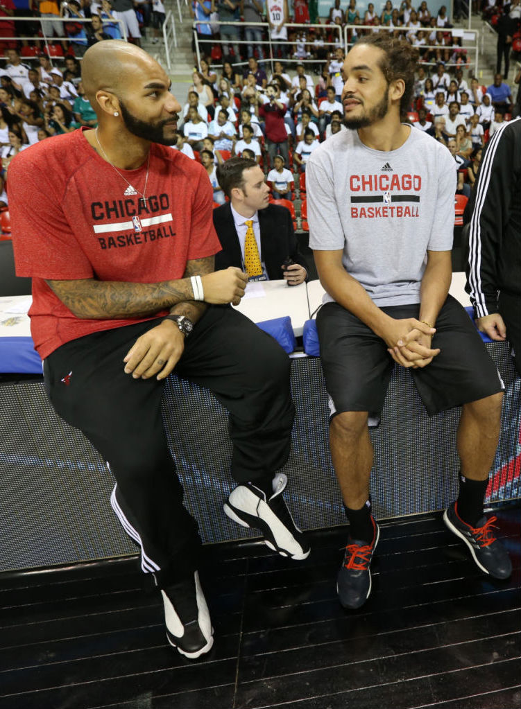 Carlos Boozer wearing Air Jordan XIII 13 Retro White/Black; Joakim Noah adidas Energy Boost