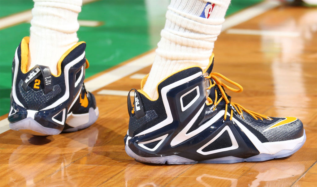 LeBron James wearing Navy/White-Yellow Nike LeBron XII 12 PE