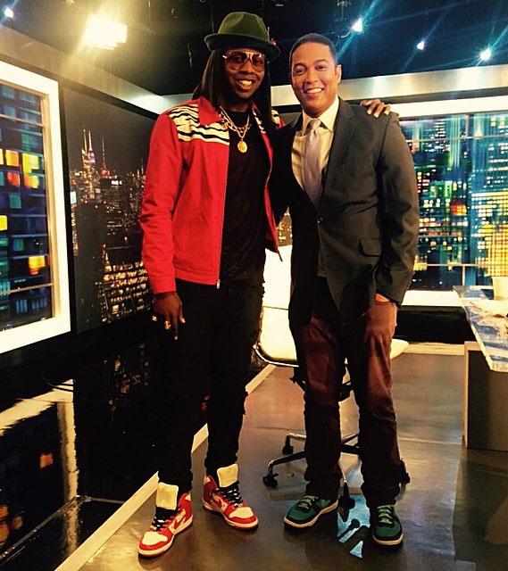 f9d498a672ea1 Trinidad James wearing the Orange Supreme Nike Dunk High