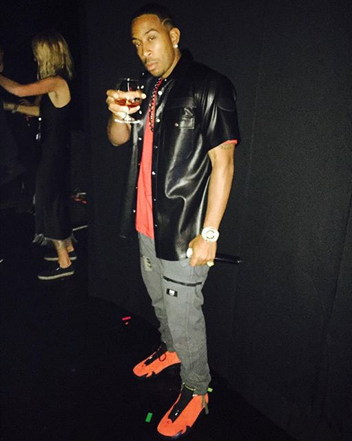 076b812d1310cd ... Ludacris wearing the Ferrari Air Jordan 14 . ...
