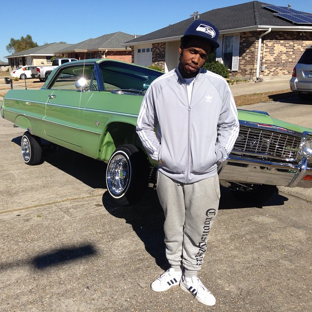 Currensy wearing adidas Originals Superstar
