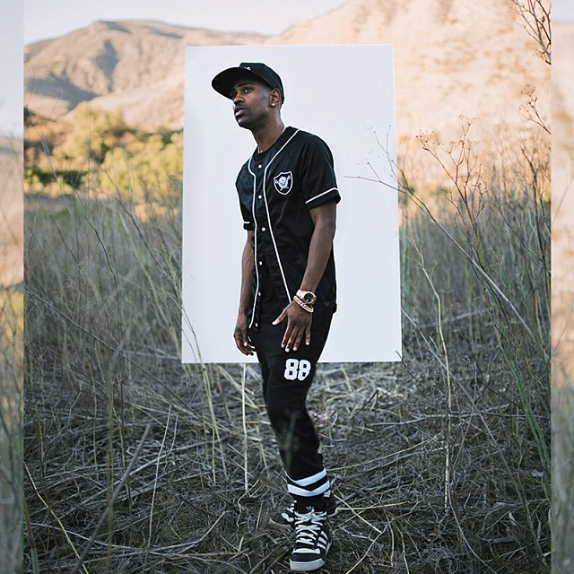 Big Sean wearing adidas Originals Rivalry Hi