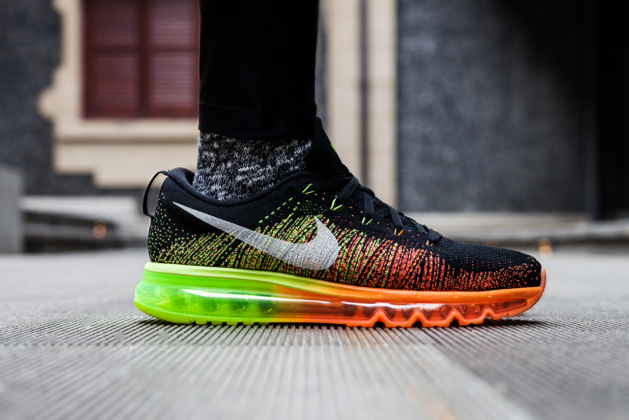 new concept 63ab5 3ea59 The Swoosh combines two of their most game-changing innovations in the  Flyknit Air Max to help kickoff 2014.