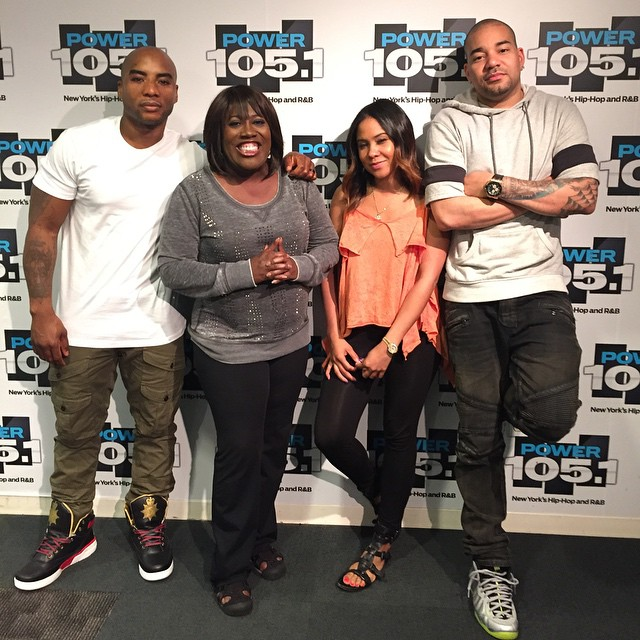 Charlamagne wearing the 'War' Ewing 33 Hi; DJ Envy wearing the 'Volt Camo' Nike Air Foamposite One