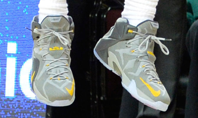 LeBron James wearing Nike LeBron XII 12 Grey/Yellow PE on November 15, 2014