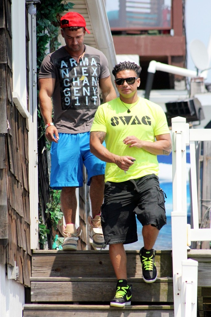 DJ Pauly D wearing Nike 6.0 Dunk High Black Grey Volt