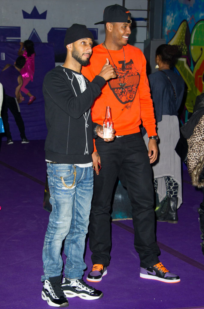 Swizz Beatz wearing BAIT x Reebok Question Snake; Carmelo Anthony wearing Air Jordan 1 I Retro